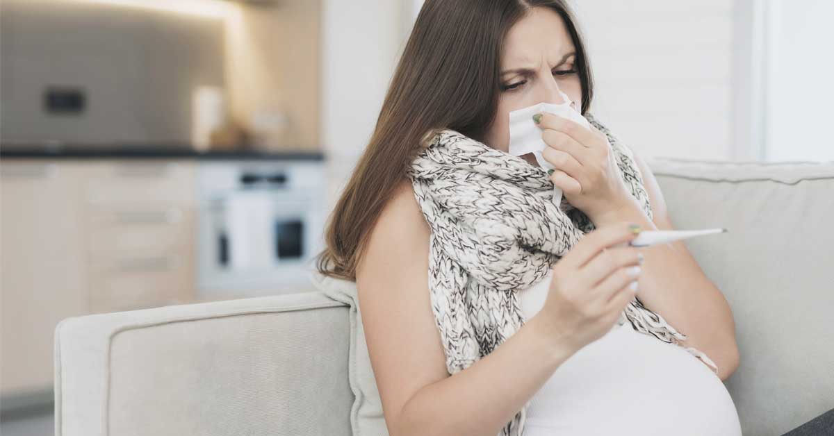 Pregnant woman experiencing fever and cold symptoms.